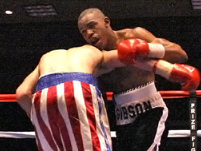 Gibson lands to the body of Henley. Photo By: Wesley Ortiz, Memphisboxing.com