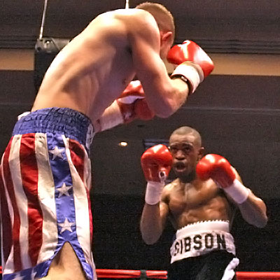 Gibson (background) vs Henley. Photo By: Wesley Ortiz, Memphisboxing.com