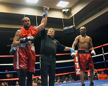 Anthony Bowman (right)--along with many in the crowd--was surprised to lose a unanimous decision versus Mike Cook. Photo: Brenden Nasianceno